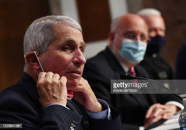 Dr Anthony Fauci director of the National Institute for Allergy and Infectious Diseases CDC Director Dr Robert Redfield and Adm Brett Giroir director...