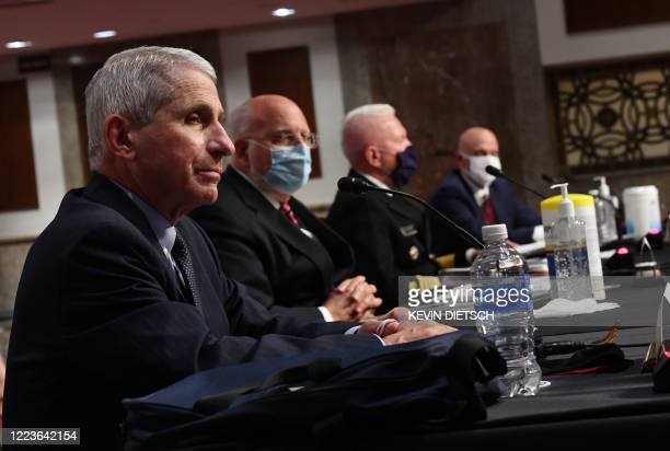 Dr Anthony Fauci director of the National Institute for Allergy and Infectious Diseases CDC Director Dr Robert Redfield Adm Brett Giroir director of...