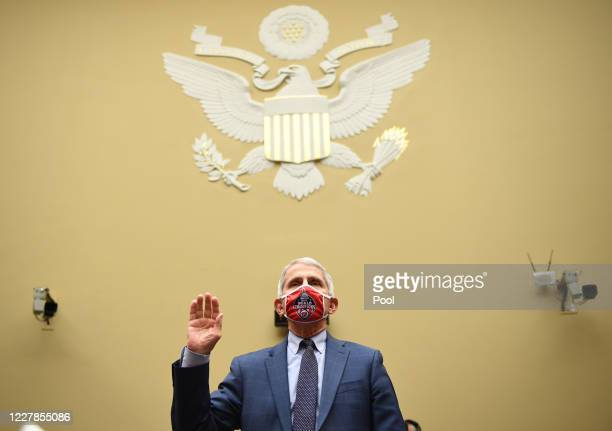 Dr. Anthony Fauci, director of the National Institute for Allergy and Infectious Diseases, is sworn in prior to testifying before a House...
