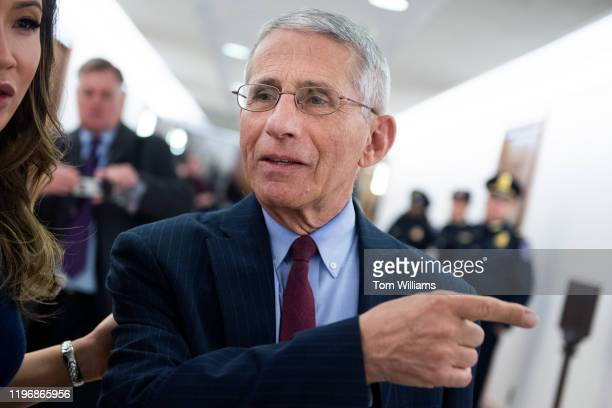 Dr Anthony Fauci director of the National Institute of Allergy and Infectious Diseases arrives to a senators briefing on the coronavirus at the...