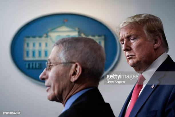 Dr. Anthony Fauci , director of the National Institute of Allergy and Infectious Diseases, speaks as U.S. President Donald Trump looks on during a...
