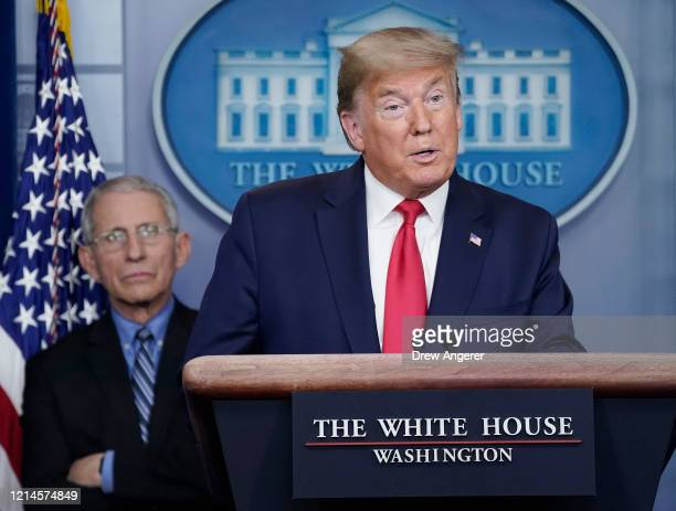 Dr. Anthony Fauci , director of the National Institute of Allergy and Infectious Diseases, listens to U.S. President Donald Trump speak during a...