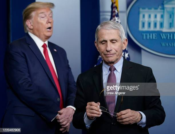 Dr. Anthony Fauci , director of the National Institute of Allergy and Infectious Diseases, and U.S. President Donald Trump participate in the daily...