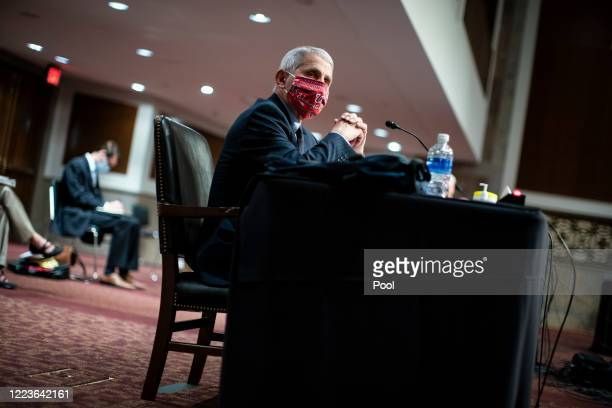 Dr. Anthony Fauci, director of the National Institute of Allergy and Infectious Diseases, listens during a Senate Health, Education, Labor and...