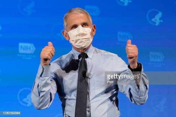 Dr. Anthony Fauci, director of the National Institute of Allergy and Infectious Diseases, gives the thumbs up after receiving his first dose of the...