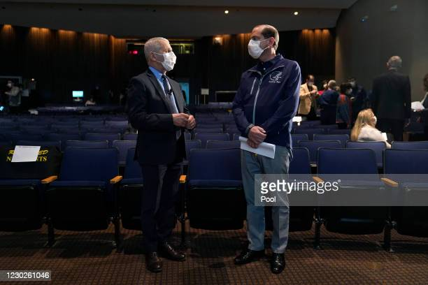 Dr. Anthony Fauci, director of the National Institute of Allergy and Infectious Diseases, speaks with Health and Human Services Secretary Alex Azar...