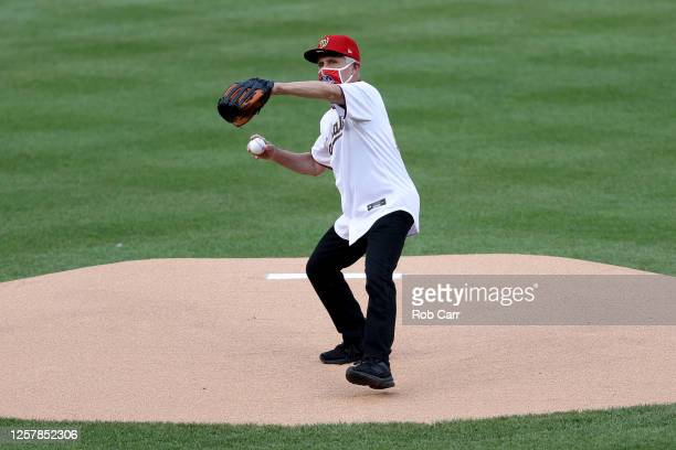 Dr. Anthony Fauci, director of the National Institute of Allergy and Infectious Diseases throws out the ceremonial first pitch prior to the game...