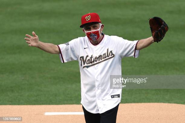Dr. Anthony Fauci, director of the National Institute of Allergy and Infectious Diseases reacts after throwing out the ceremonial first pitch prior...