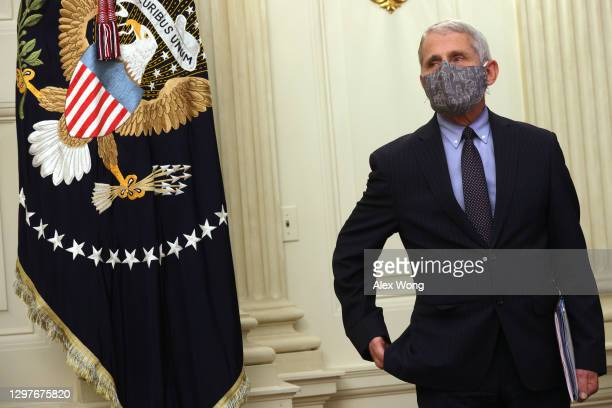 Dr Anthony Fauci, Director of the National Institute of Allergy and Infectious Diseases, listens during an event at the State Dining Room of the...