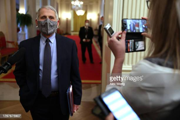 Dr Anthony Fauci, Director of the National Institute of Allergy and Infectious Diseases, talks to members of the press prior to an event at the State...