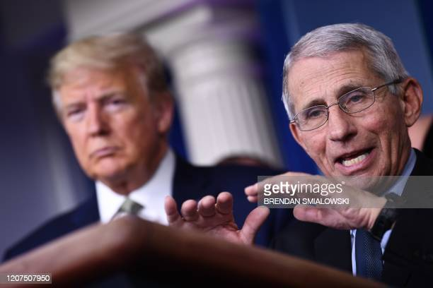 Dr. Anthony Fauci speaks as US President Donald Trump listens during the daily press briefing on the Coronavirus pandemic situation at the White...