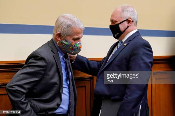 Dr. Anthony Fauci, the nation's top infectious disease expert, left, talks with House Minority Whip Steve Scalise, R-La., following a House Select...