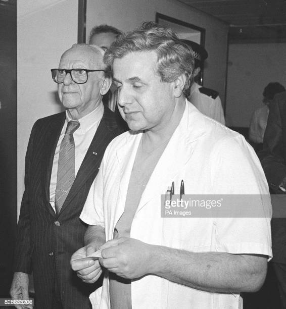 Dr Armand Hammer 90yearold chairman of Los Angelesbased Occidental Petroleum is accompanied by Graham Page Aberdeen Royal Infirmary's accident and...