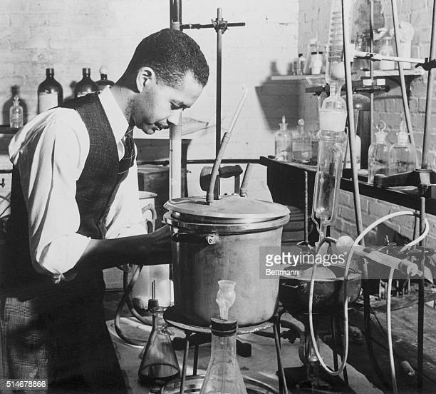 Dr Austin W Curtis Jr chemist and assistant to Dr George Washington Carver conducts an experiment in a laboratory of the Tuskegee Institute in Alabama