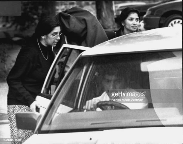 Dr Balakrishnan leaving court today with his supporters helping him into the car June 27 1994