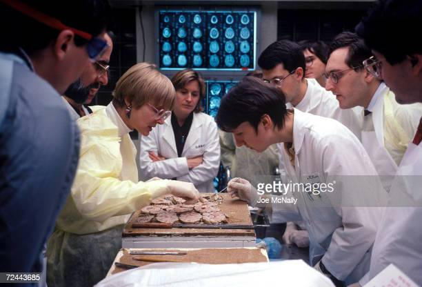 Dr. Barbara Crain , a neuropathoplogist, leads a lecture and demonstration on gross abnormailties of the brain in the autopsy room at Johns Hopkins...