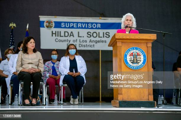 Dr. Barbara Ferrer, director of the L.A. County Department of Public Health speaks as Los Angeles County Supervisor Hilda Solis looks on during a...