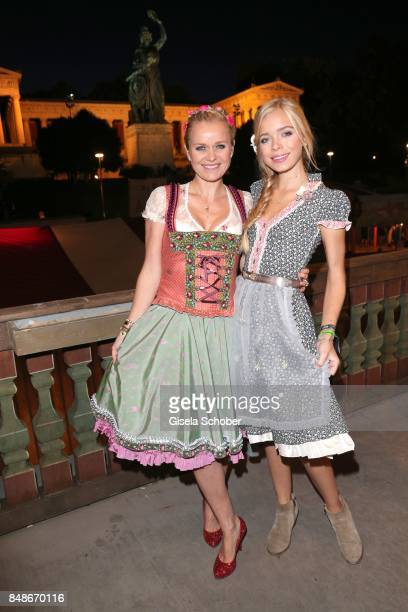 Dr Barbara Sturm and her daughter Charly Sturm wearing a dirndl by Lola Paltinger during the 'Almauftrieb' as part of the Oktoberfest 2017 at...
