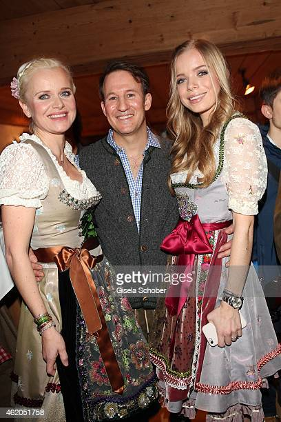 Dr. Barbara Sturm and her husband Adam Waldman and her daughter Charly Sturm wearing a Dirndl of Lola Paltinger during the Weisswurstparty at Hotel...