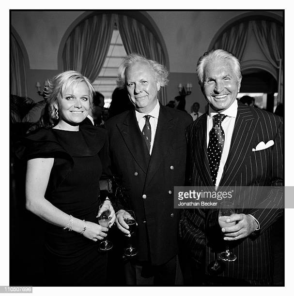 Dr Barbara Sturm editor of Vanity Fair Graydon Carter and actor George Hamilton are photographed at Vanity Fair Cannes Party at the Eden Roc Cap...