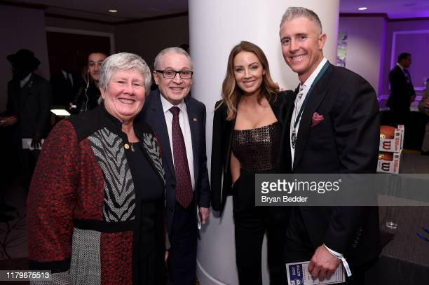 Dr Barth Green Jennifer Cooper and Chase Utley attend the Legends Reception during the 34th Annual Great Sports Legends Dinner To Benefit The...