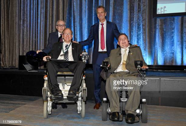 Dr Barth Green Jim Langevin Marc Buoniconti and Cris Collinsworth pose onstage during 2the 34th Annual Great Sports Legends Dinner To Benefit The...