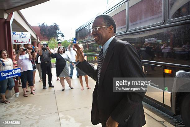 Dr Ben Carson surgeon and conservative icon waves to supporters as he passes them Monday Aug 25 as he arrives for a book signing at a Barnes and...