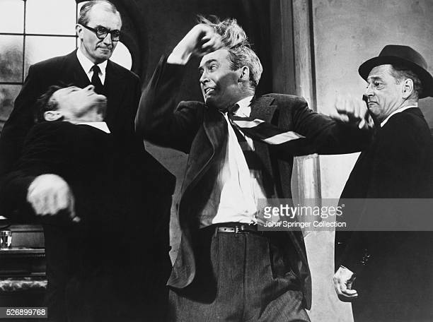 Dr Ben McKenna punches another man in the face in the 1956 Hitchcock film The Man Who Knew Too Much