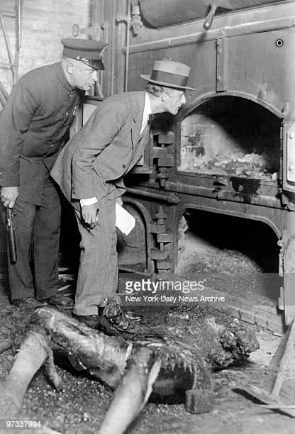 Dr Benjamin Schwartz and Patrolman Ben Kantor examine the furnace where the burned body of Ms Poleski was found