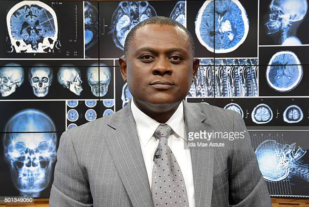 AMERICA Dr Bennet Omalu a forensic pathologist whose research linked brain damage to concussions suffered by professional football players appears on...