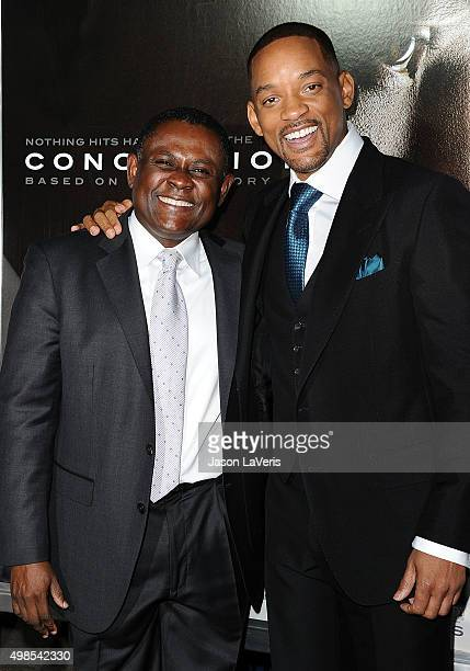 Dr Bennet Omalu and actor Will Smith attend a screening of Concussion at Regency Village Theatre on November 23 2015 in Westwood California