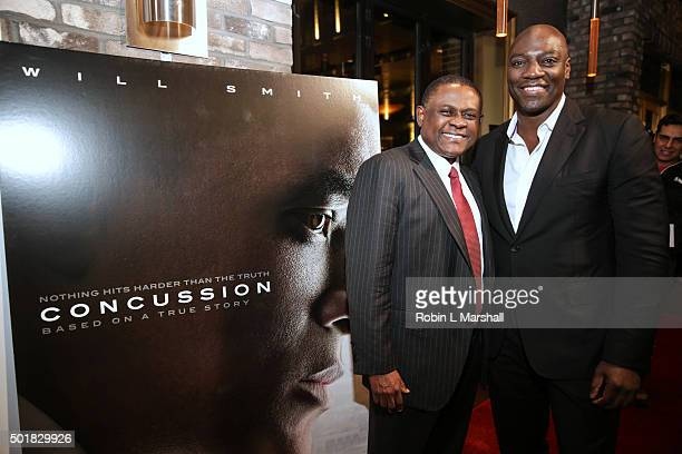 Dr Bennet Omalu and Adewale AkinnuoyeAgbaje attend Concussion Atlanta Screening at Cinebistro Town Brookhaven on December 17 2015 in Atlanta Georgia