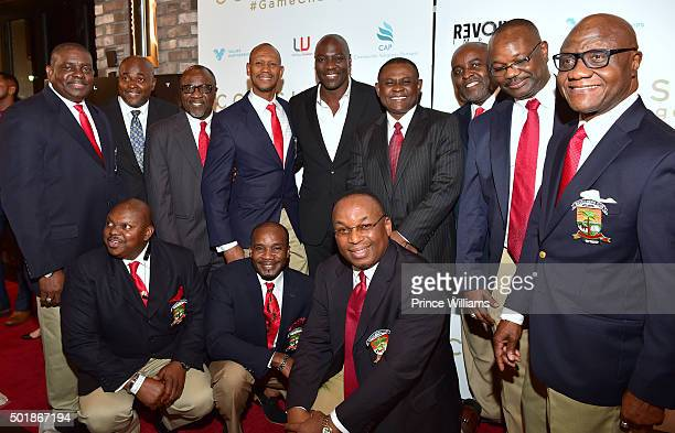 Dr Bennet Omalu and Adewale AkinnuoyeAgbaje with the Enugu Mens Club at the 'Concussion' Atlanta screening at Cinebistro Town Brookhaven on December...