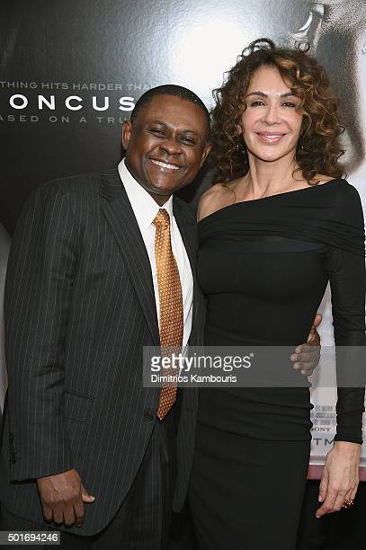 Dr Bennet Omalu and Giannina Scott attend theConcussion New York Premiere at AMC Loews Lincoln Square on December 16 2015 in New York City