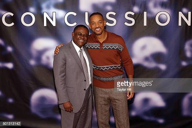 Dr Bennet Omalu and Will Smith attend a photocall for Concussion at Crosby Street Hotel on December 14 2015 in New York City