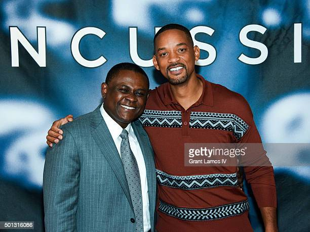 Dr Bennet Omalu and Will Smith attend the Concussion Cast Photo Call at Crosby Street Hotel on December 14 2015 in New York City