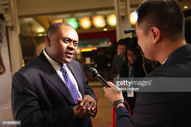 Dr Bennet Omalu attends the Concussion Washington DC Premiere at Regal Cinemas Gallery Place 14 on December 9 2015 in Washington DC