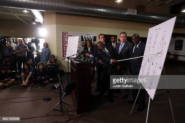 Dr Bennet Omalu attorney Dale Galipo attorney Brian Panish and attorney Ben Crump examine a picture showing gunshot wounds to Stephon Clark during a...