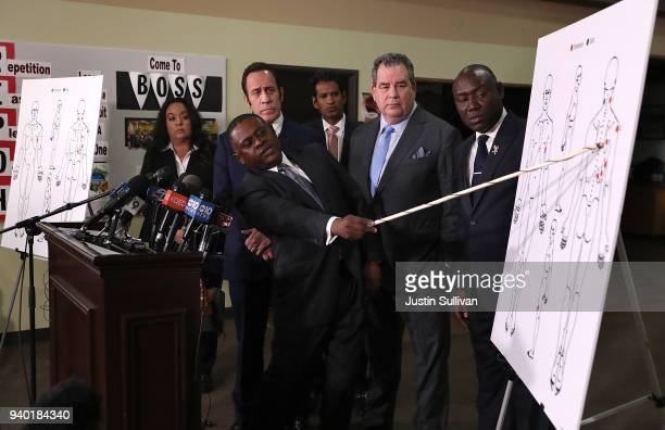 Dr Bennet Omalu attorney Dale Galipo attorney Brian Panish and attorney Ben Crump examine a diagram showing gunshot wounds to Stephon Clark during a...