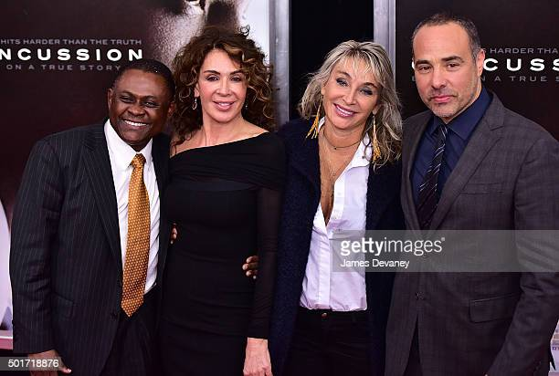 Dr Bennet Omalu Giannina Scott guest and Peter Landesman attend the Concussion premiere at AMC Loews Lincoln Square on December 16 2015 in New York...