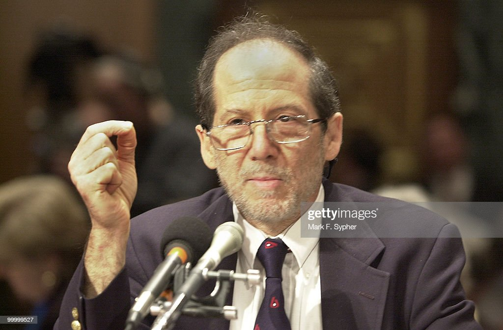 Dr. Bert Vogelstein, of Howard Hughes Medical Institute, questions the signifigance of a hair strand.