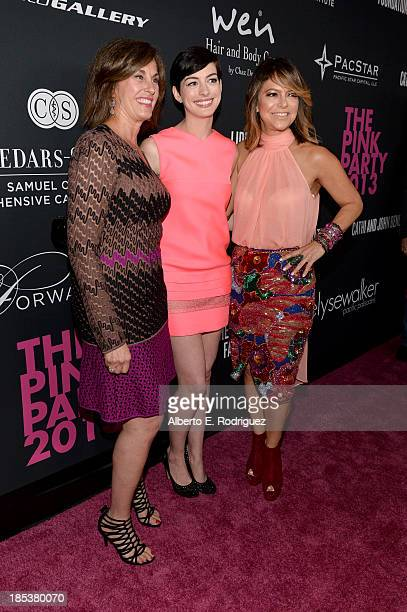 Dr Beth Y Karlan MD Director of CedarsSinai Women's Cancer Program host Anne Hathaway and Pink Party Founder Elyse Walker attend Elyse Walker...