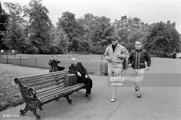 Dr Billy Graham who has to keep fit for his London campaign trotted and walked in Hyde Park today In sports gear which gave him the impression of a...