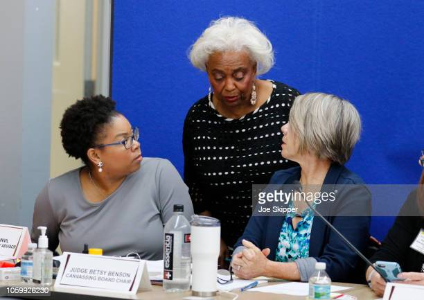 Dr. Brenda Snipes, Broward County Supervisor of Elections, center, confers with Daphnee Sainuk, left and Betsy Benson, canvassing board chair, during...