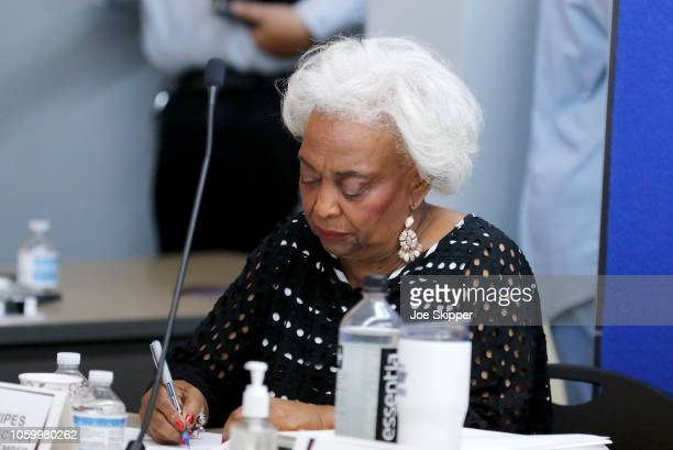 Dr. Brenda Snipes, Broward County Supervisor of Elections, signs results with other canvassing board members after they were transmitted to the state...