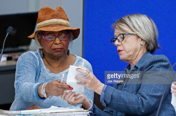 Dr. Brenda Snipes, left, Broward County Supervisor of Elections, speaks with Judge Betsy Benson, canvassing board chair, prior to the start of a...
