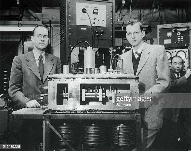 Dr Charles H Townes left winner of the 1964 Nobel Prize in Physics and an associate Dr JP Gordon are pictured with the first maser It was constructed...