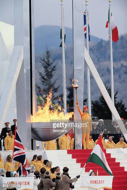 Dr Charles Morgan Kerr holds his torch aloft after lighting the Olympic flame 2/13 during opening ceremonies for the 1980 Winter Olympic games