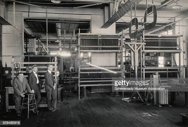 Dr Charles P Steinmetz his son Joseph L Hayden and his assistant NA Lougee experiment with artificial lightning in Steinmetz' laboratory at General...