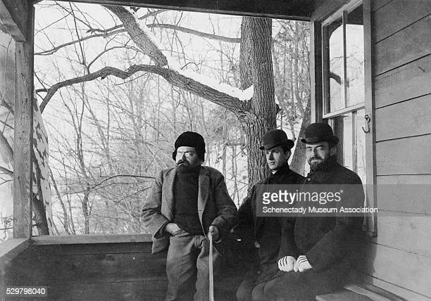 Dr Charles Steinmetz John Dempster and Dr Willis Whitney sit on the porch of the new GE research laboratory at Steinmetz' farm in Schenectady shortly...